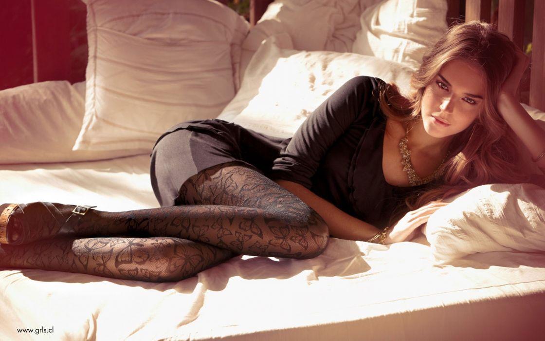 Brunettes women dress stockings lying down wallpaper