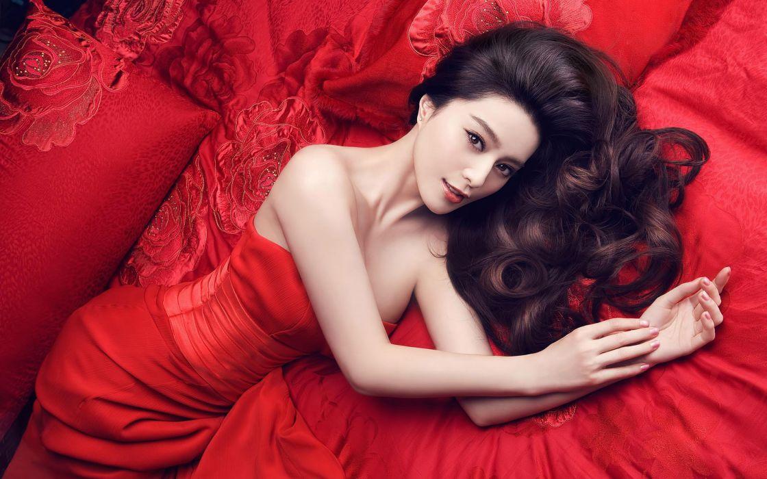 Women beds asians pillows red dress curly hair lying down wallpaper