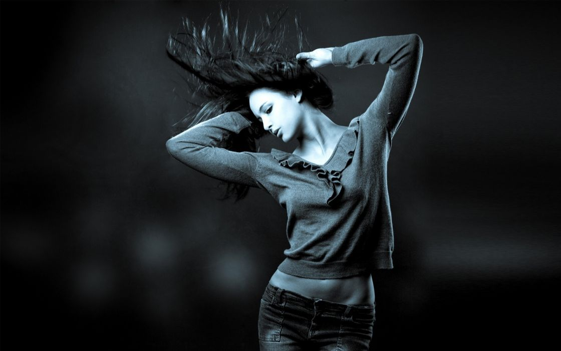 Women jeans monochrome hair toss blurred looking down exposed midriff arms raised wallpaper