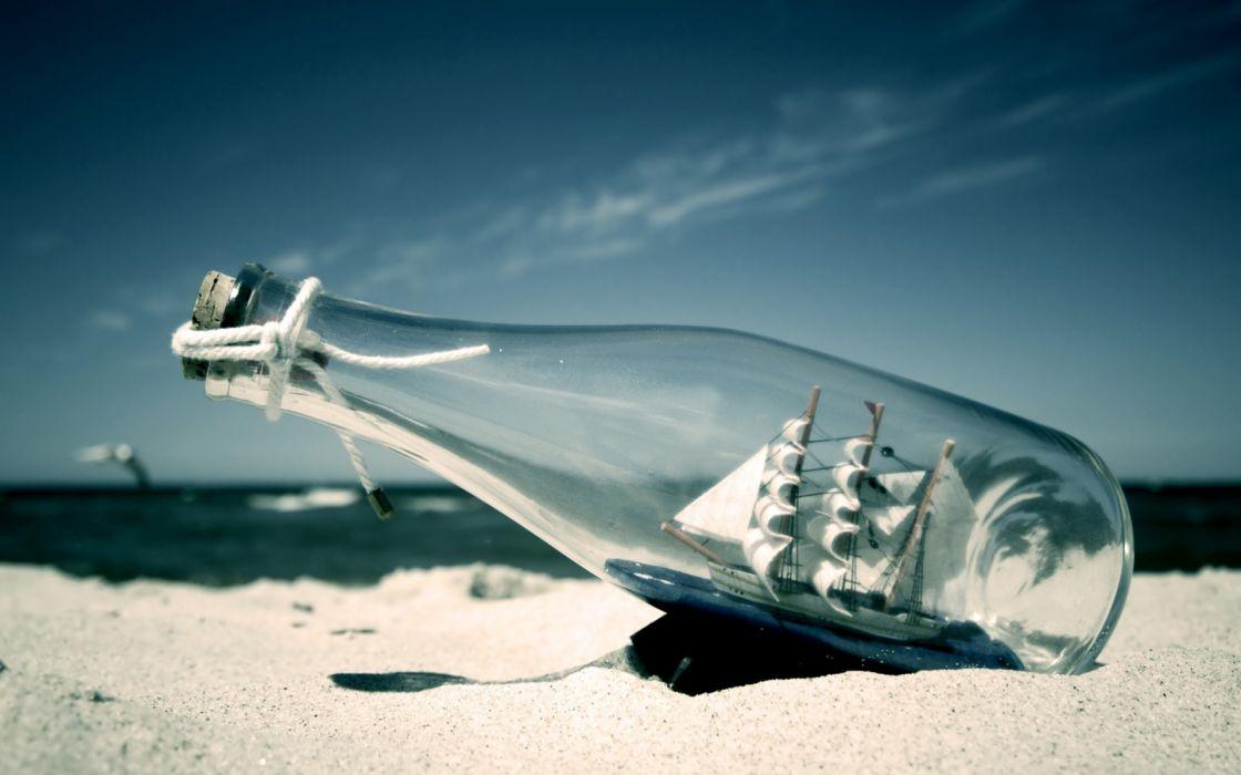 Beach sand bottles ships wallpaper