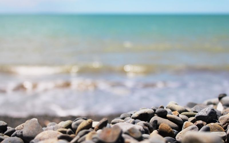 Beach stones depth of field wallpaper
