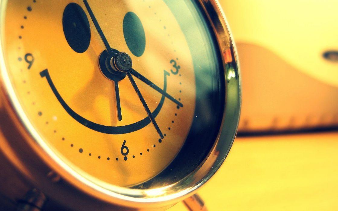 Yellow happy smiley face alarm clocks wallpaper
