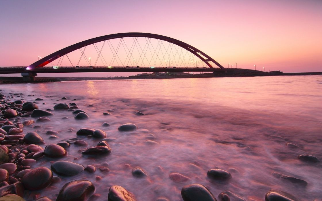 Sunset seas rock bridges sunlight wallpaper