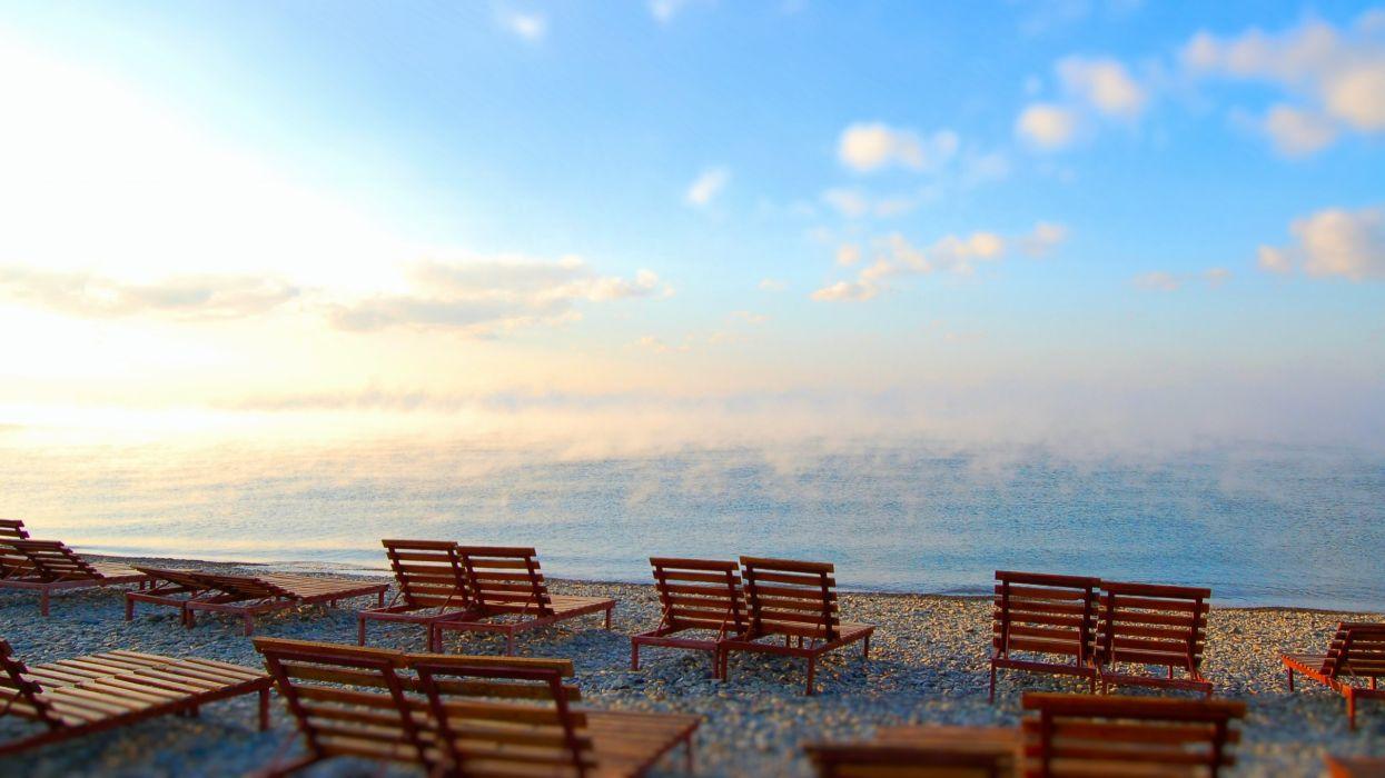 Sun beach seas fog chairs blue skies wallpaper