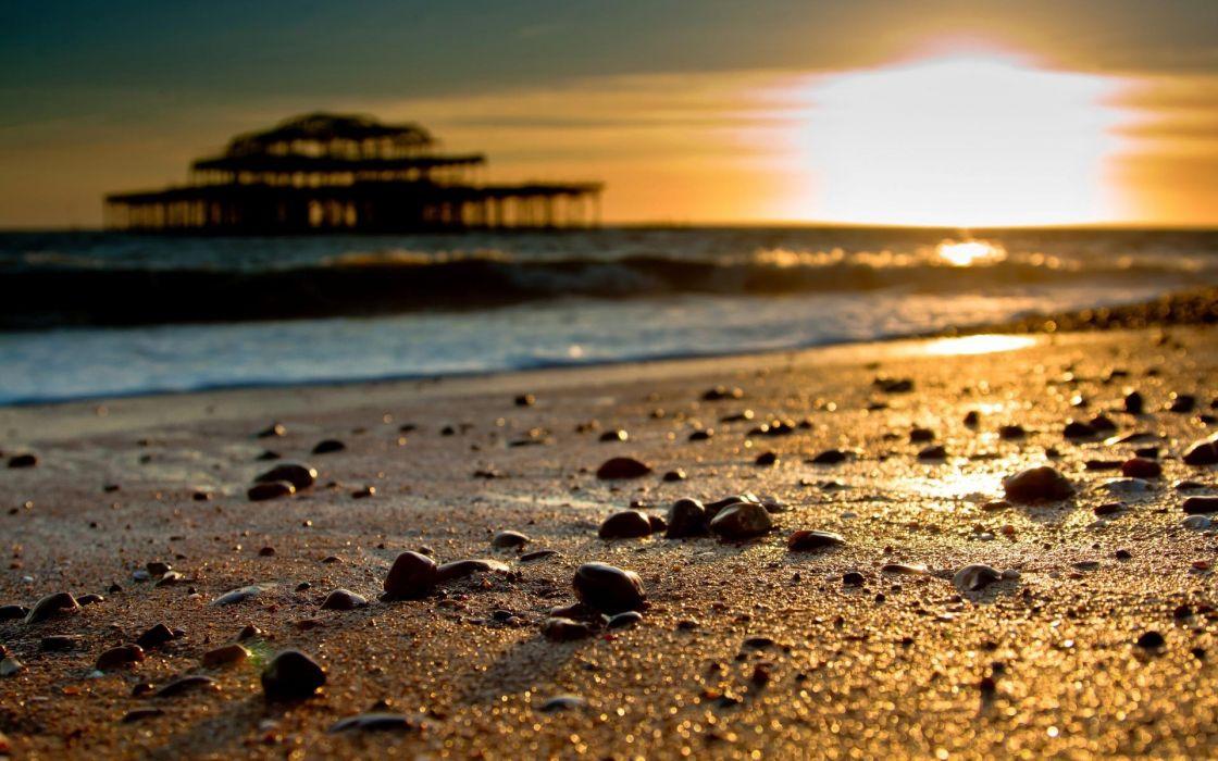 Sunrise beach pebbles wallpaper