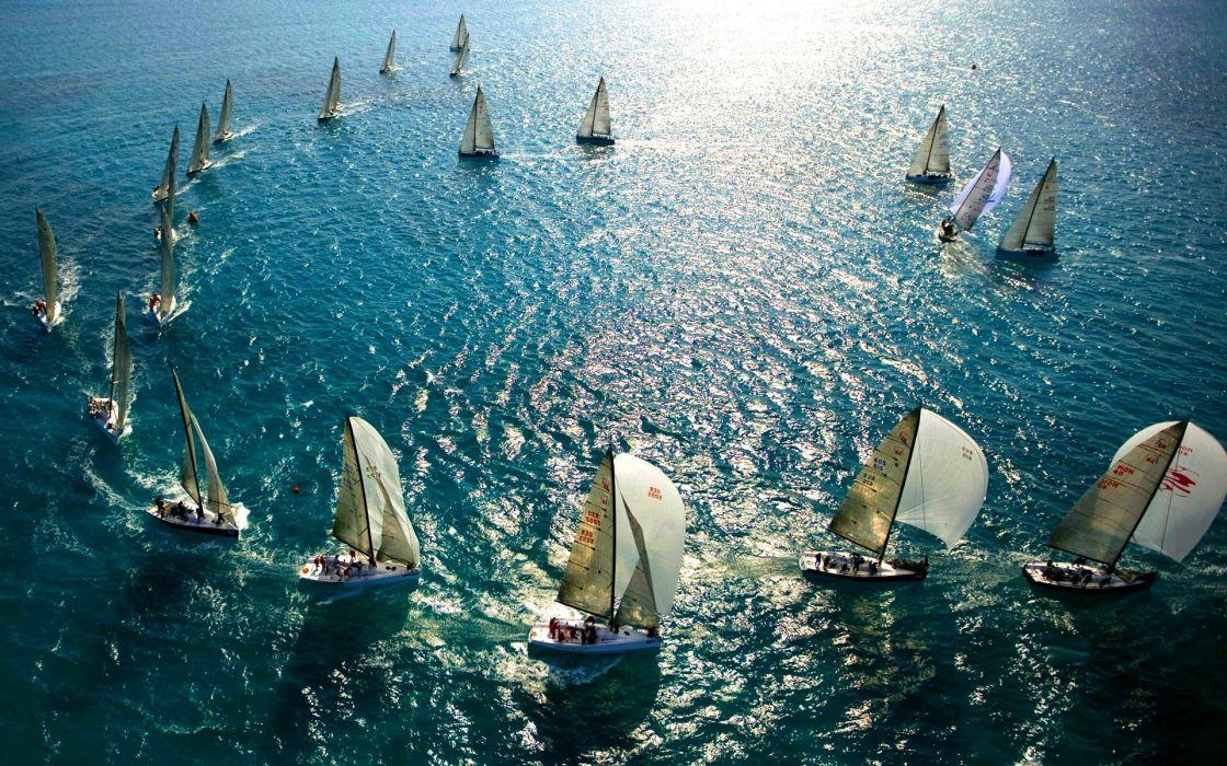 vehicles watercrafts boats sail-boats sailing sports oceans seas water sunlight reflections wallpaper