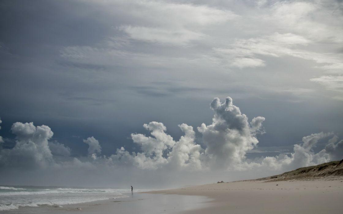Water clouds nature coast beach sand seas people blue skies wallpaper