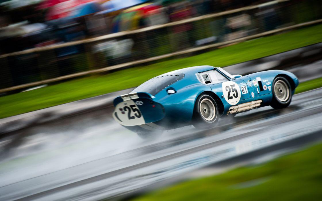 Cobra fords racecars race-cars vehicles rain storms race-tracks racing wallpaper