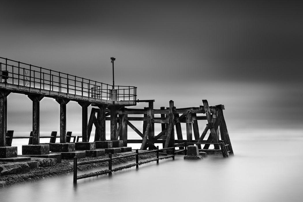 pier dock ruins decay ocean sea timelapse skies clouds black white black-and-white wallpaper