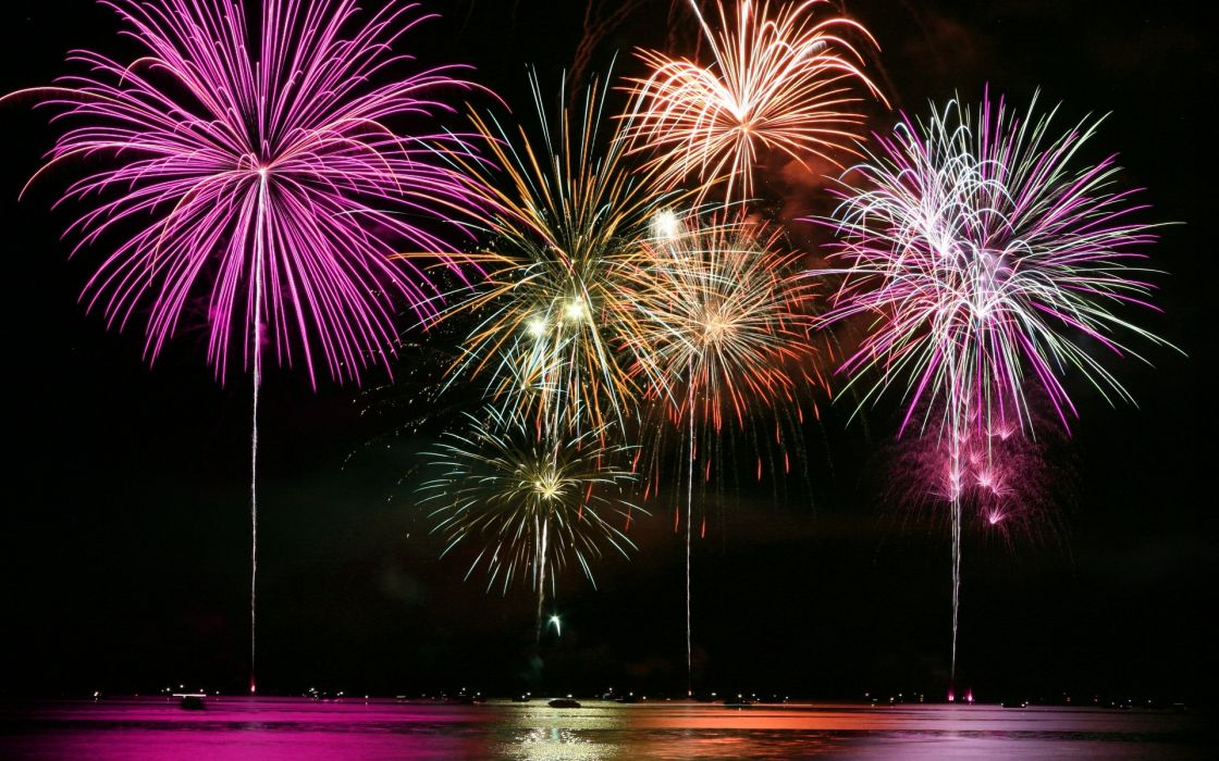 festive fireworks fire explosion colors night water reflection sparkle sparks wallpaper