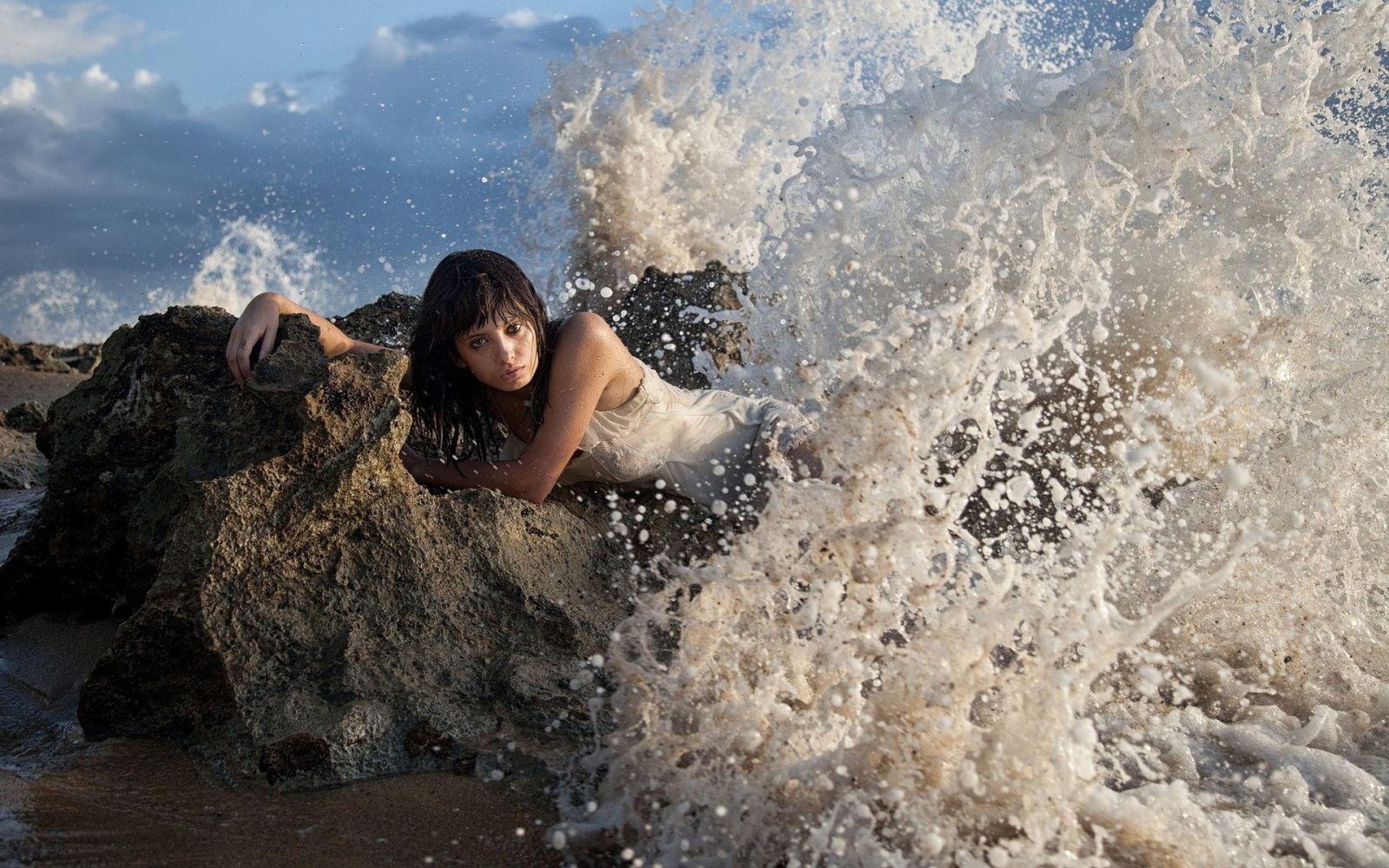 Nude woman standing in ocean lagoon by trinette reed