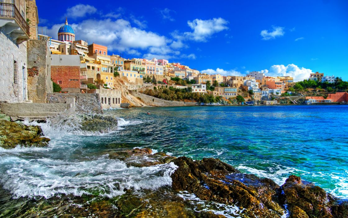 Greek islands Syros greece architecture buildings houses cliff shore coast tropical sky clouds trees ocean sea water waves rocks wallpaper