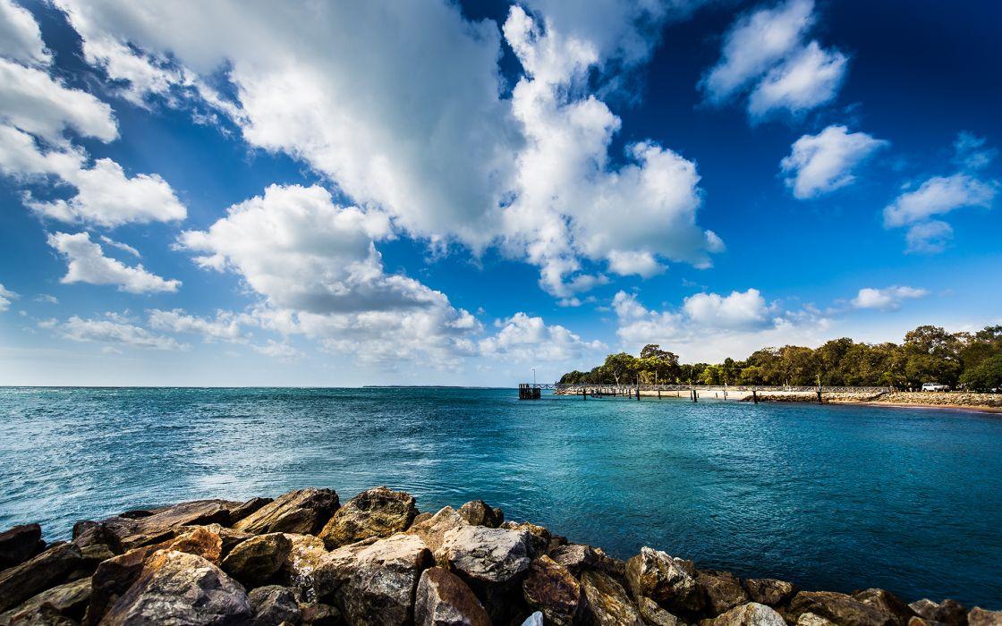landscape nature seascape ocean sea rocks shore coast water trees tropical sky clouds scenic wallpaper