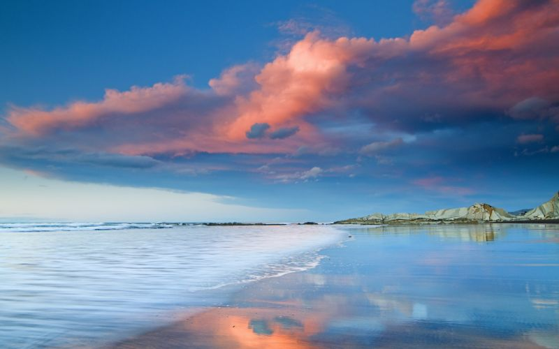 nature landscapes beaches reflection water ocean sea waves sky clouds sunset sunrise mountains hills tropical sand scenic storm wallpaper