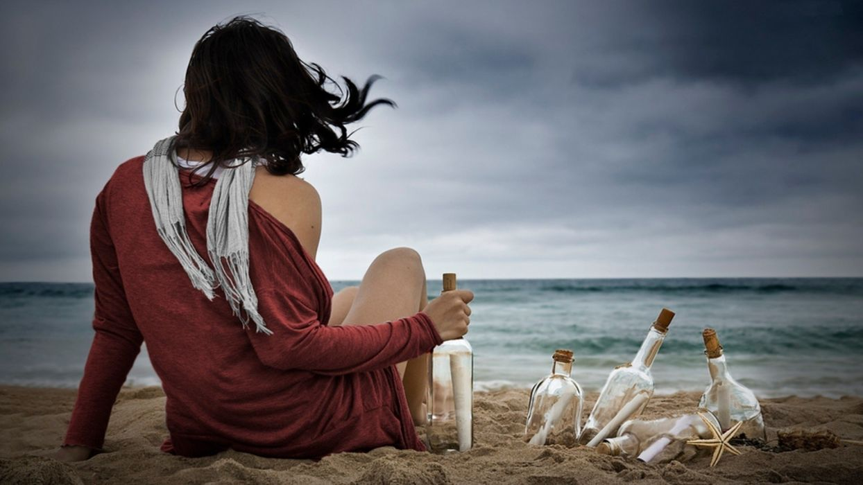 mood emotion alone sad sorrow wait hope message bottle cork communication landscapes nature beaches sand ocean sea waves scenic view sky clouds storm legs brunette sexy sensual babes wind weather women female girl situation wallpaper