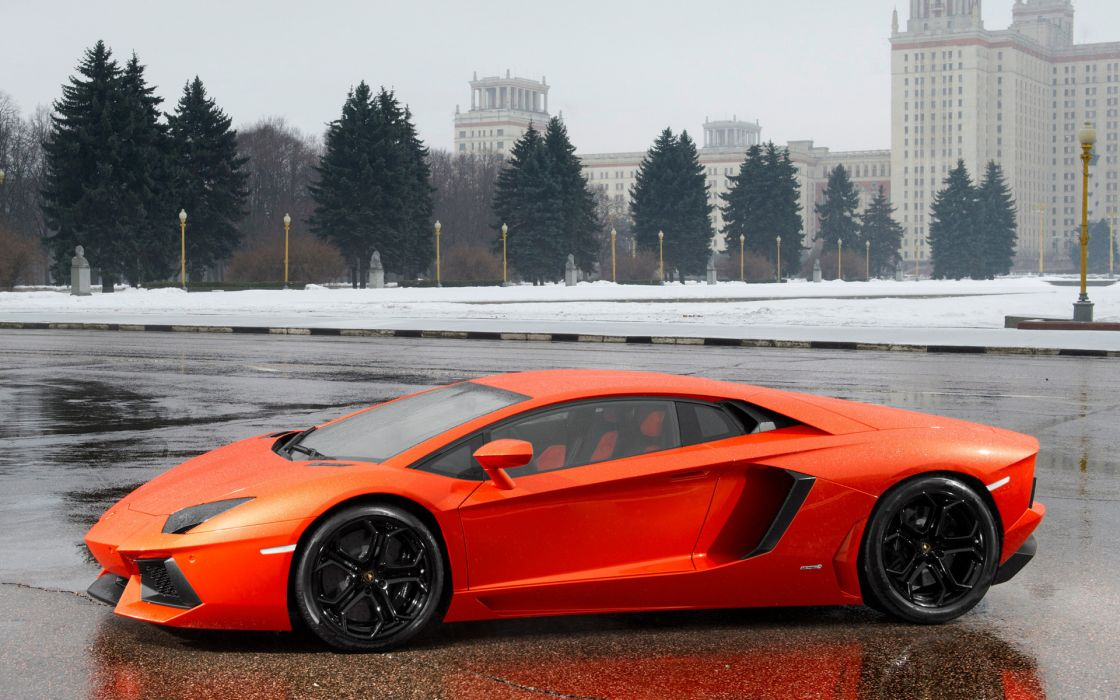 vehicles cars lamborghini super exotic sports wheels orange roads architecture buildings winter snow seasons trees wet water wallpaper