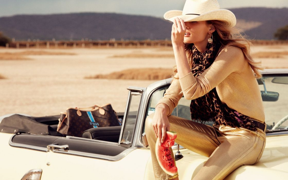 Edita Vilkeviciute Lithuanian vehicles cars classic old retro hat cowboy fashion style legs brunette pose face desert landscapes mountains sand roads sexy sensual babes women girls females models food watermelon fruit stare look wallpaper