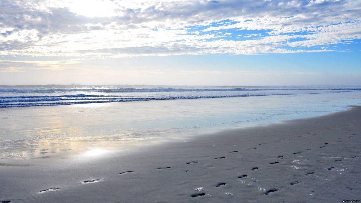 nature landscapes beaches shore coast zen tracks footprints waves ocean sea water sky clouds sunlight scenic view wallpaper
