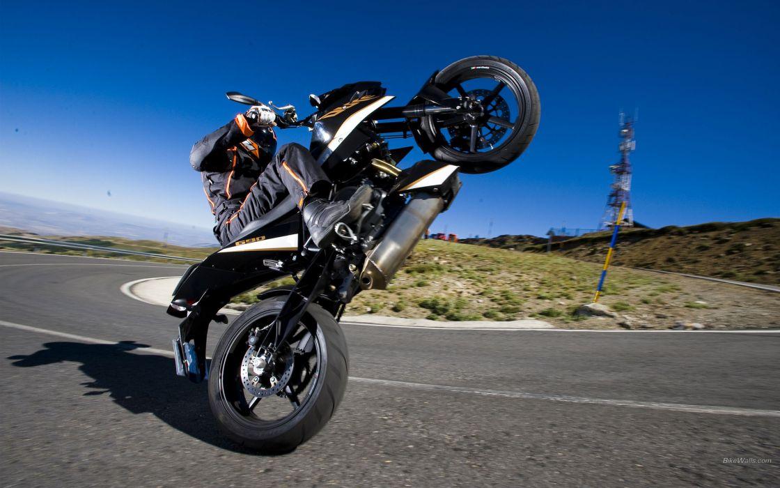 690 Duke 2011 vehicles motorcycles motorbike wheelie whell stand extreme people roads engines sportbkie bike wallpaper