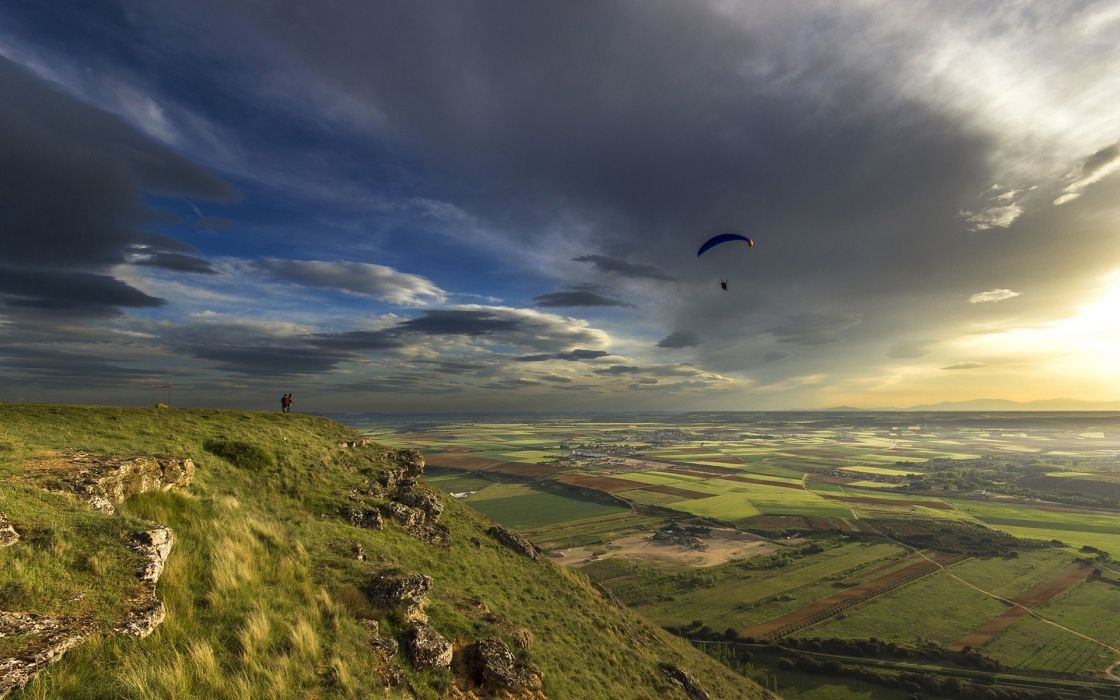 parachute skydiving sky clouds sunlight sunset sunrise flight fly people mountains hills nature landscapes fields grass plants green scenic view wallpaper