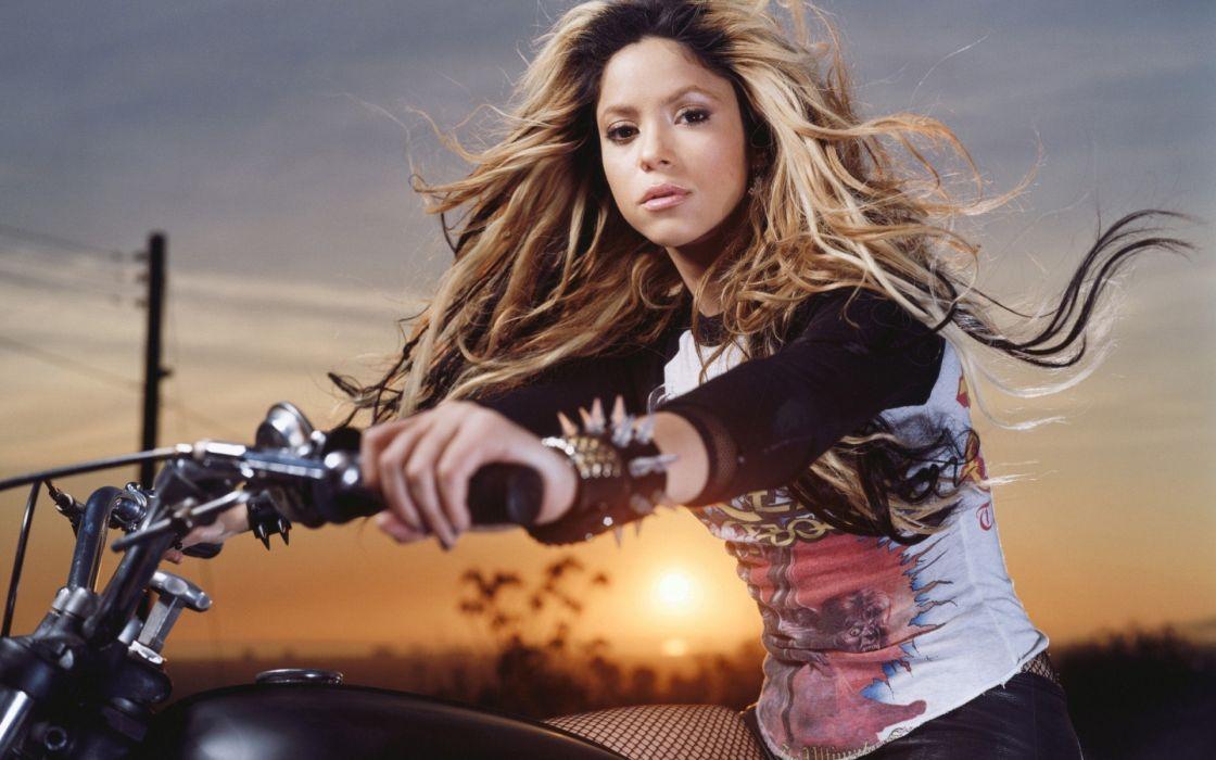 Shakira music singer groups bands musician blondes hair style women females girls babes sexy sensual celebrities people face eyes vehicles motorcycles motorbikes bike sunset sunrise sky wallpaper