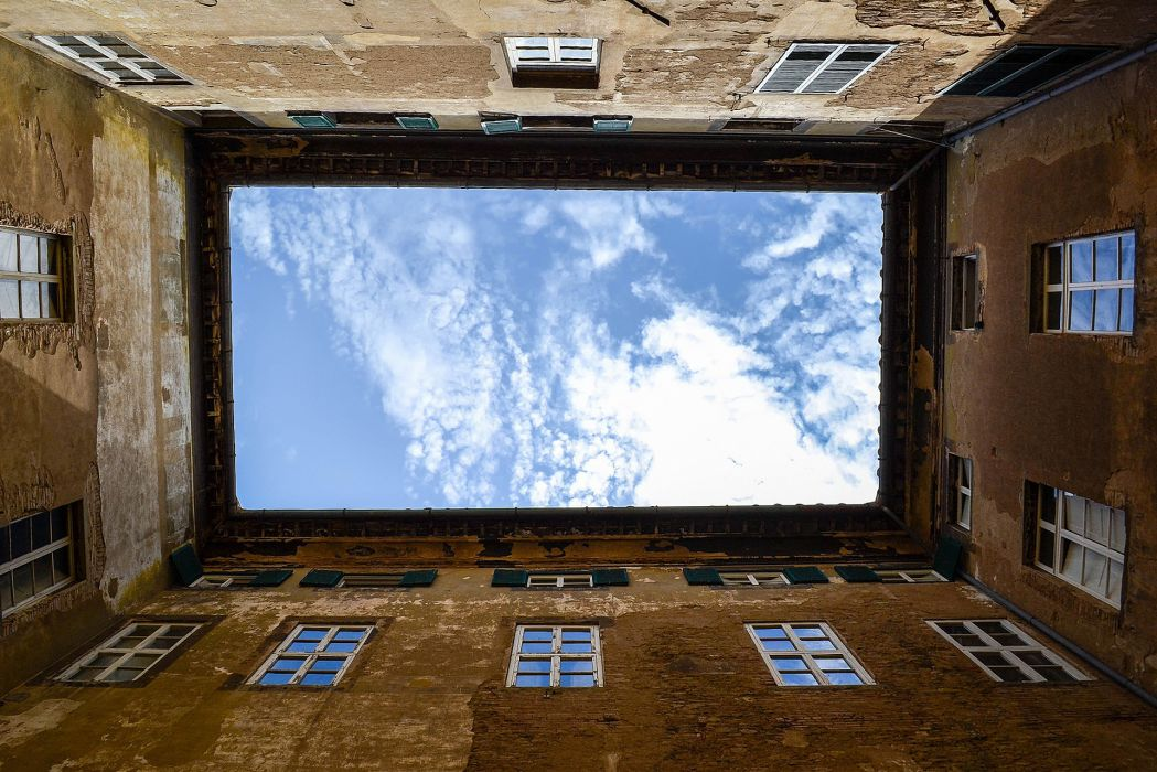 architecture buildings apartments houses window glass pane sky clouds scenic view photography hole rectangle  wallpaper