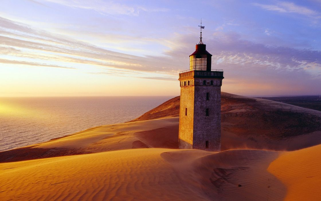 architecture buildings lighthouse lamp light hills landscapes sand dune sunset sunrise scenic view ocean sea water sky clouds reflection glass window stone wallpaper