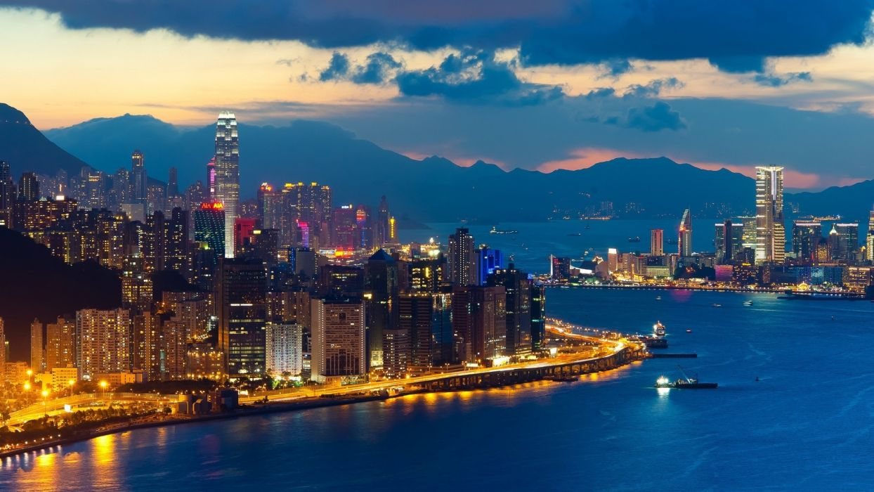 Hong Kong world architecture cities buildings skyscrapers night lights hdr window signs neon shore sound bay water vehicles ships skyline cityscape mountains sky clouds sunset sunrise scenic wallpaper