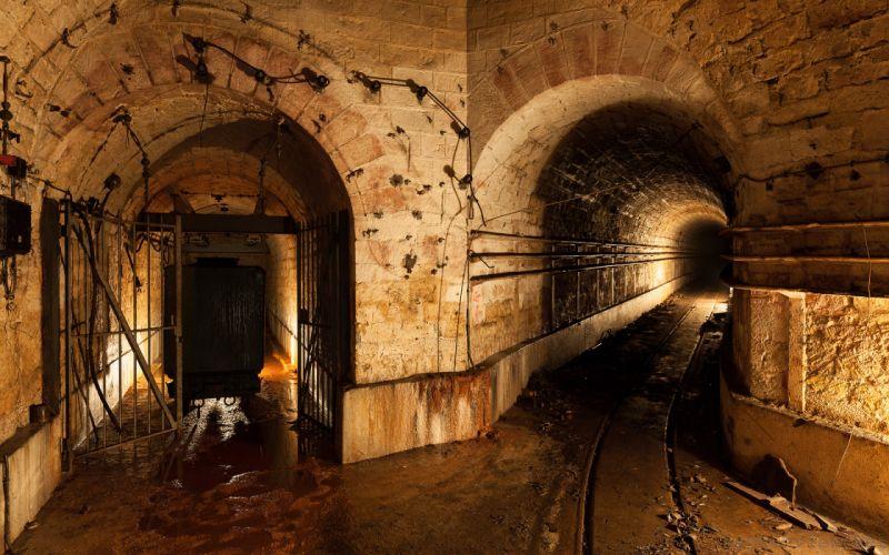 world architecture buildings tunnels stone rock railroad tracks rail lights cave mine wallpaper