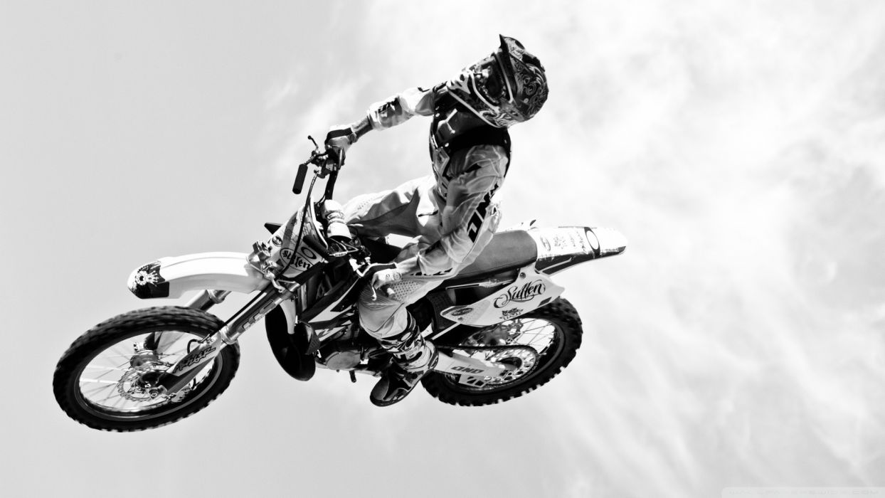 dirtbike moto vehicles motorcycle motorbike bike flight fly black white wheels people uniform sky clouds extreme sports racing cross wallpaper