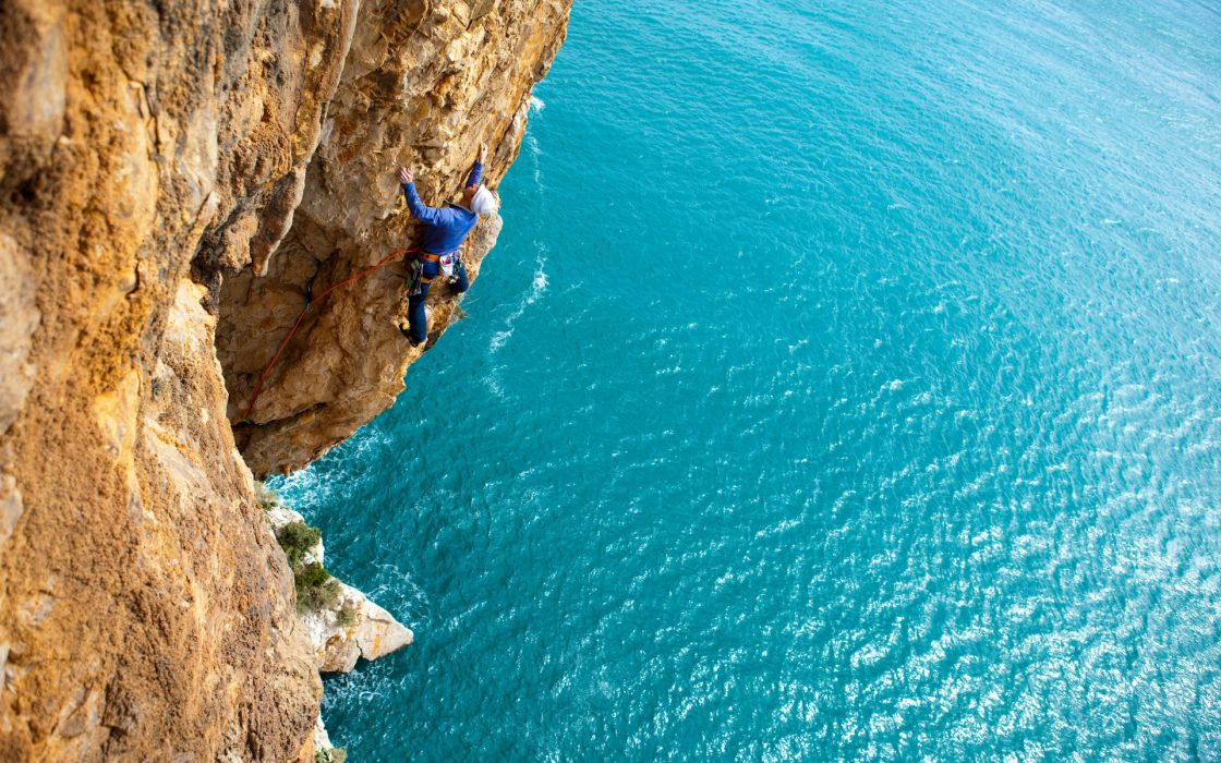 climbing sports nature rope man men males cliff mountains ocean sea water sparkle wallpaper