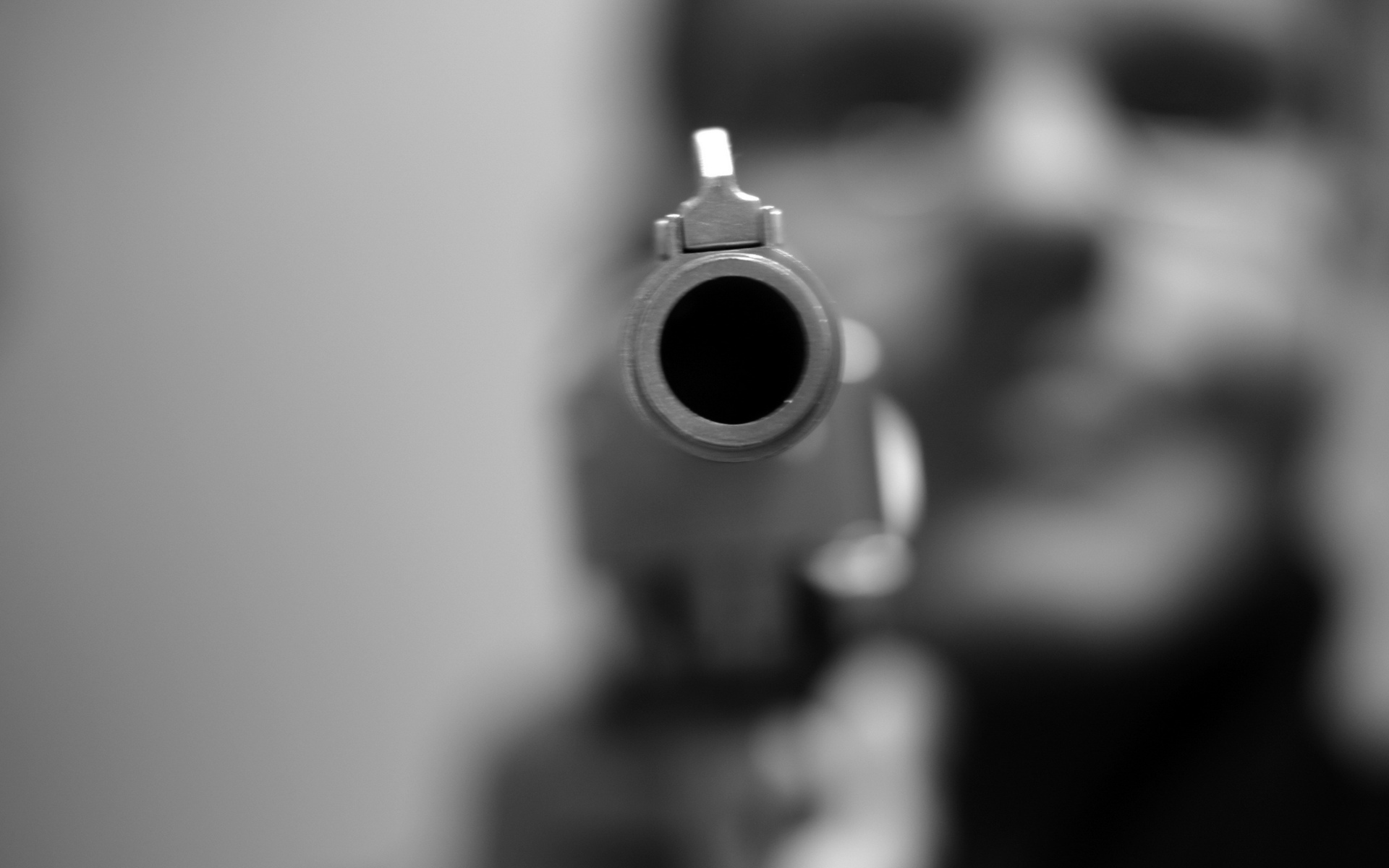 Weapons guns pistol black white photography barrel hole circle shape metal steel men male boy people pov face eyes mood situation emotion angry violence