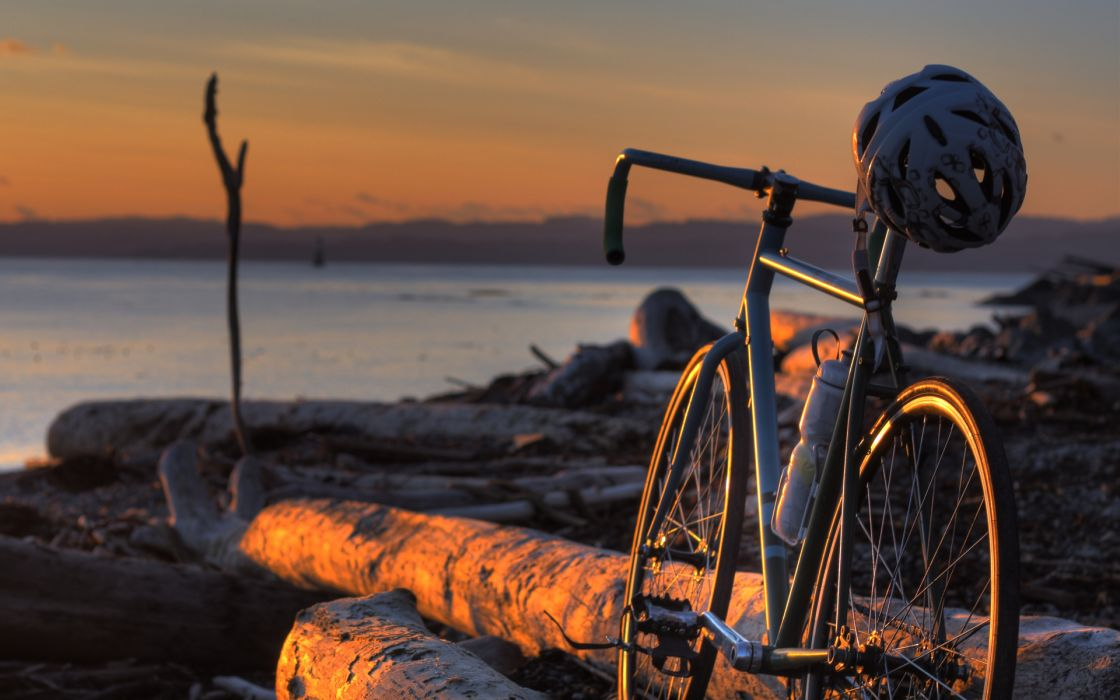Vehicles bicycle bike wheels frame mech spokes helmet hat sports landscapes beaches driftwood wood lakes water sunset sunrise sky clouds wallpaper