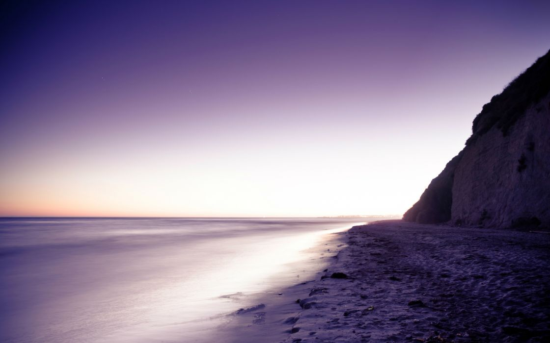 nature landscapes beaches cliff hills sand tide purple sunrise sunset sky ocean sea water tracks footprint wallpaper
