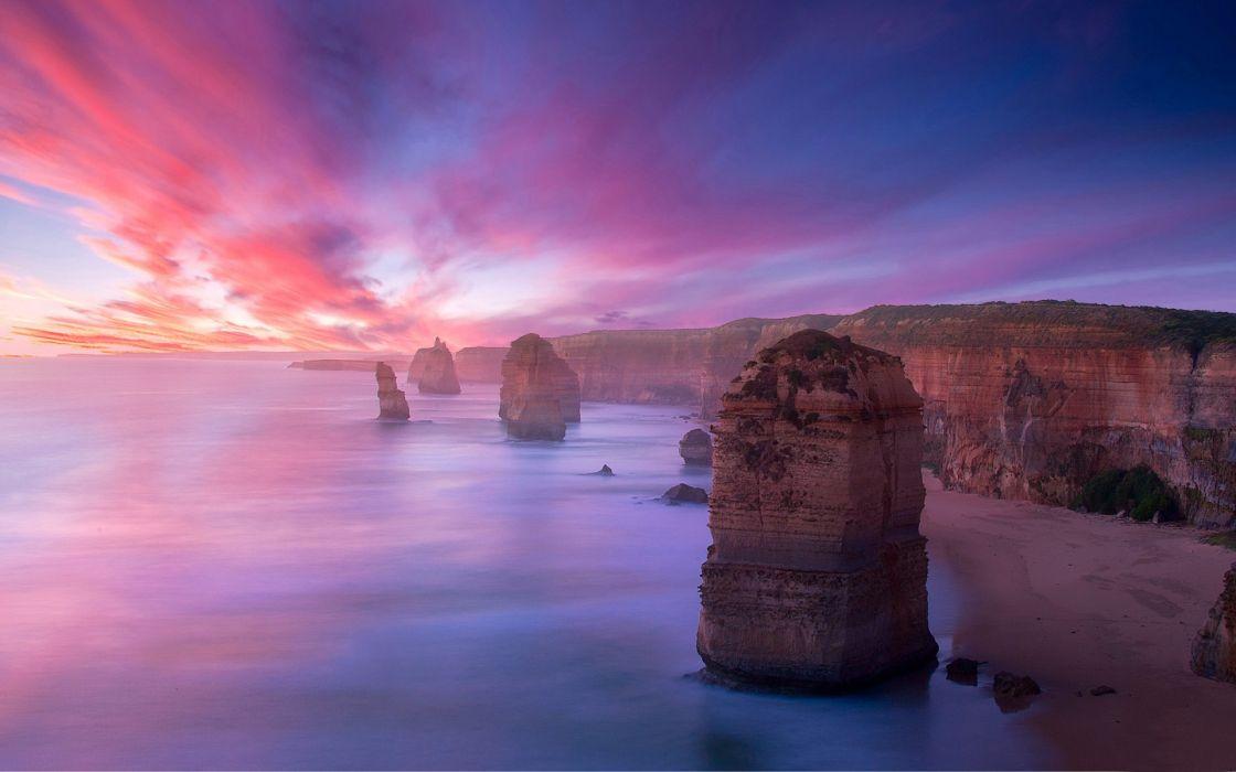 nature landscapes cliff hills beaches island rock stone ocean sea seascape sky clouds color sunset sunrise scenic wallpaper
