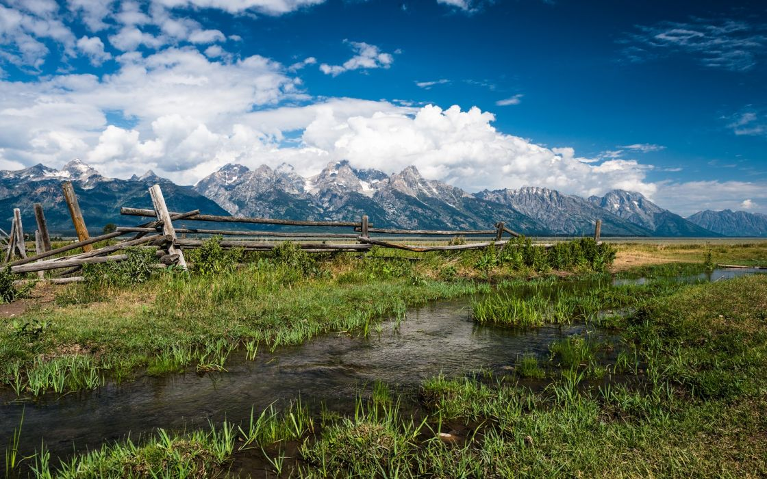 Grand Teton National Park nature landscapes meadow fields rivers streams water reflection grass fence mountains snow peaks sky clouds scenic wallpaper