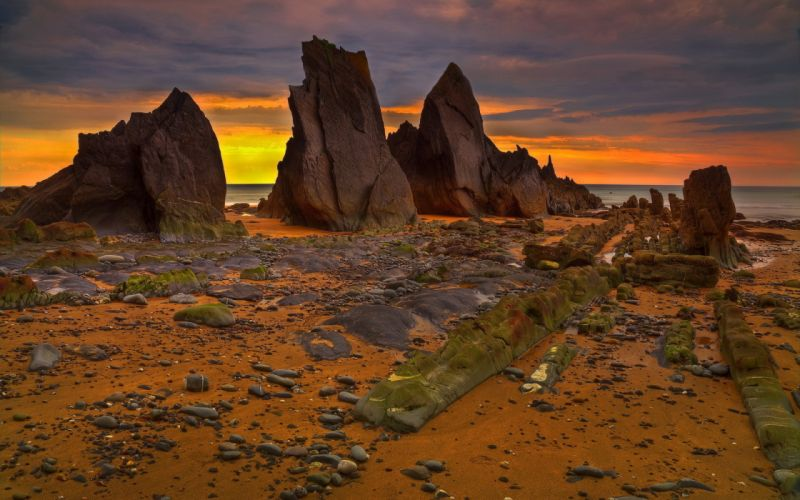 nature landscapes beaches stone rock sand cropping ocean sea water scenic sky clouds color sunset sunrise sun wallpaper