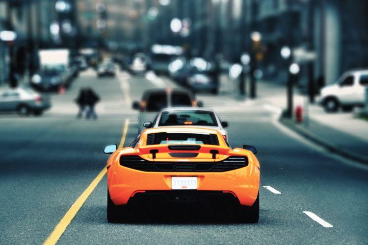 Mclaren selective roads vehicles cars auto supercar orange color cities wallpaper