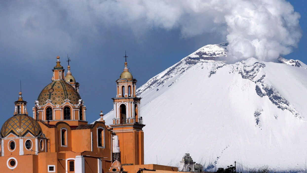 Popocatepetl Volcano Cholula Mexico eruption smoke steam nature mountains snow architecture buildings cathedral church cross wallpaper