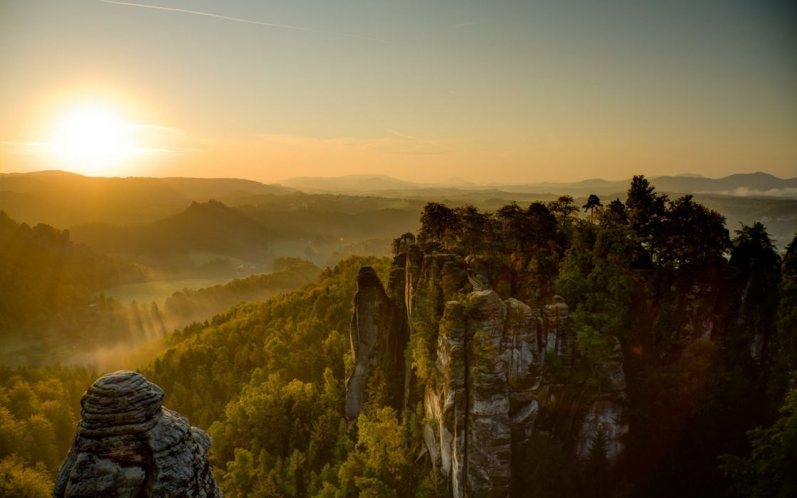 nature landscapes trees forest cliff spire valley hills scenic sky sunset sunrise sunlight wallpaper