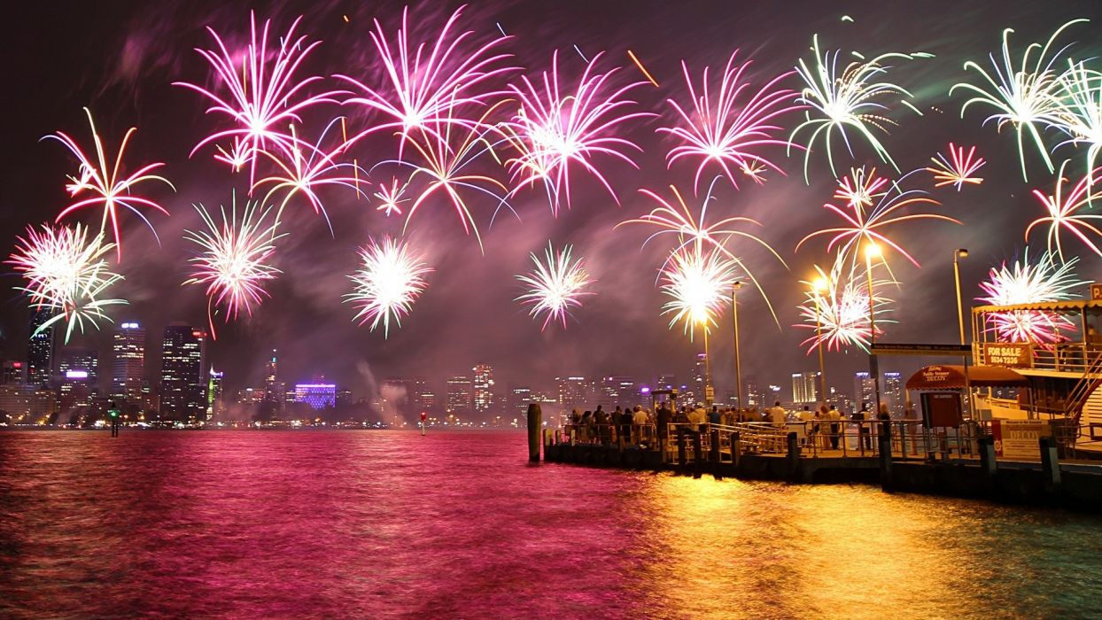 New Year 4th fourth july holidays fireworks color sparkle bright light world architecture buildings skyscraper skyline cityscape might harbor bay water reflection ocean sea wallpaper