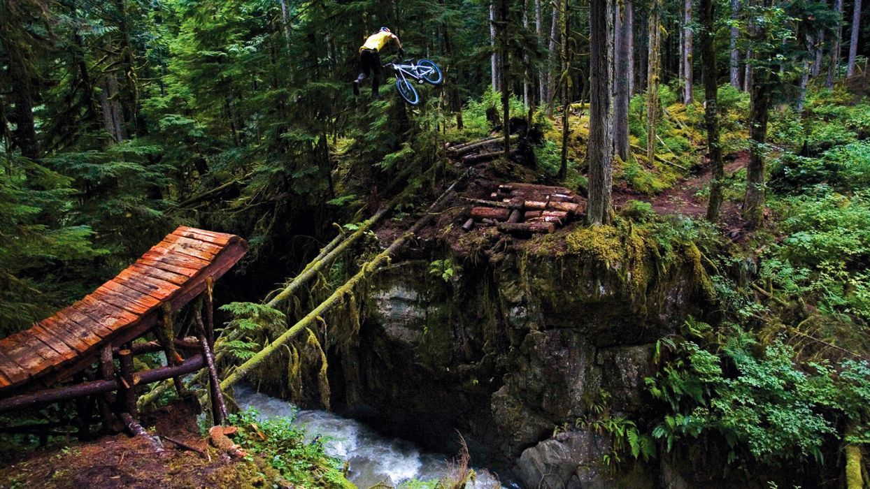bicycle extreme junp trees forest rivers landscapes people mood wallpaper