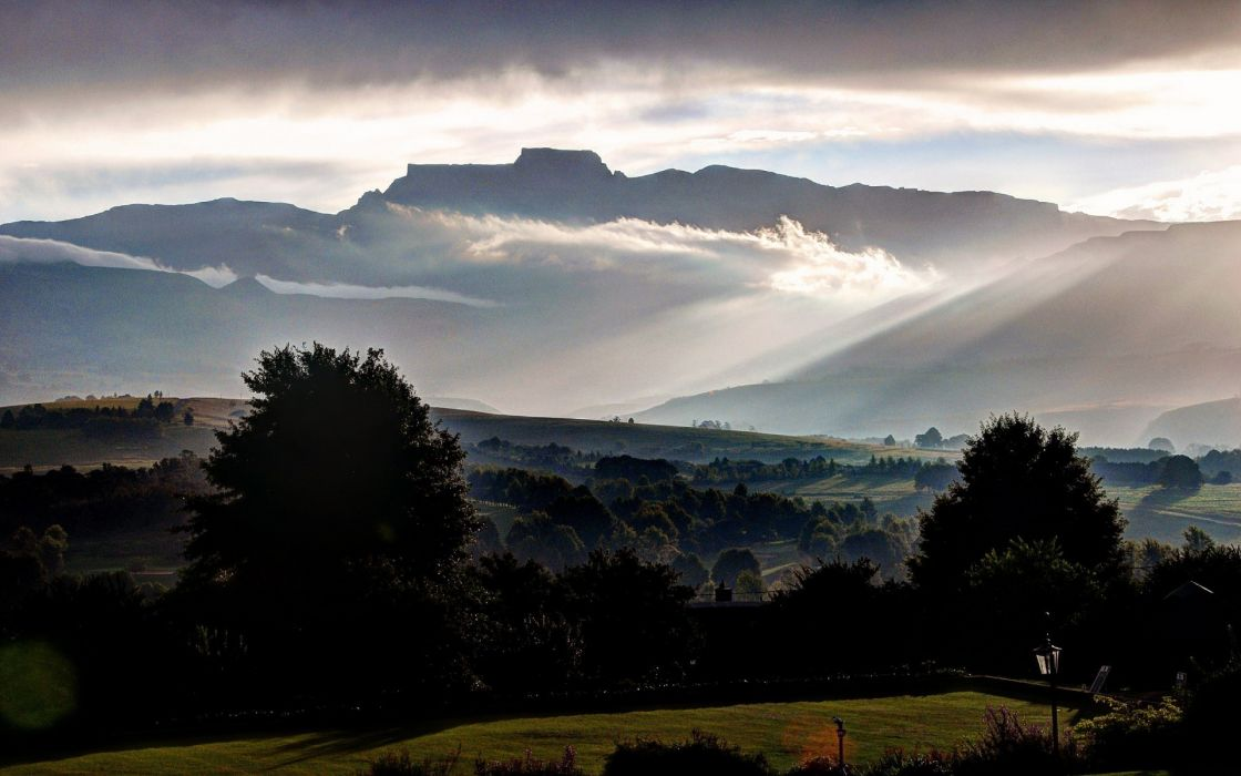 Champagne Castle Drakensberg South Africa buildings trees fog clouds mountains sky wallpaper