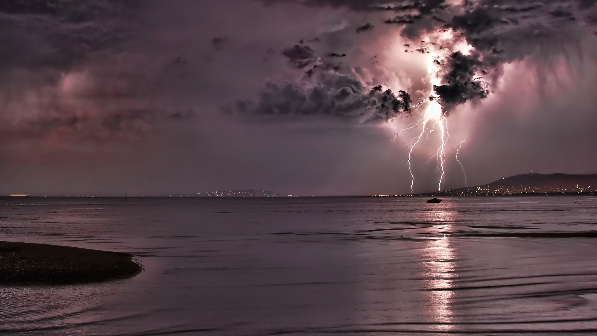 Lightning storm rain clouds electric water reflection ...