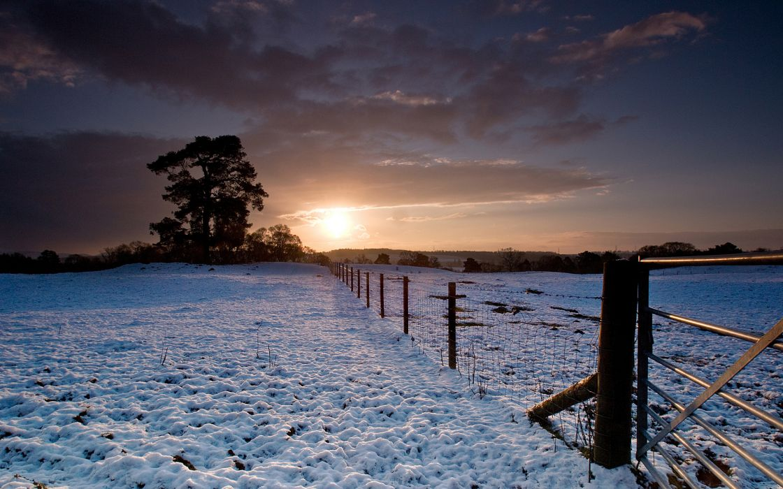 fields winter snow sunset sunrise sky clouds fence trees wallpaper