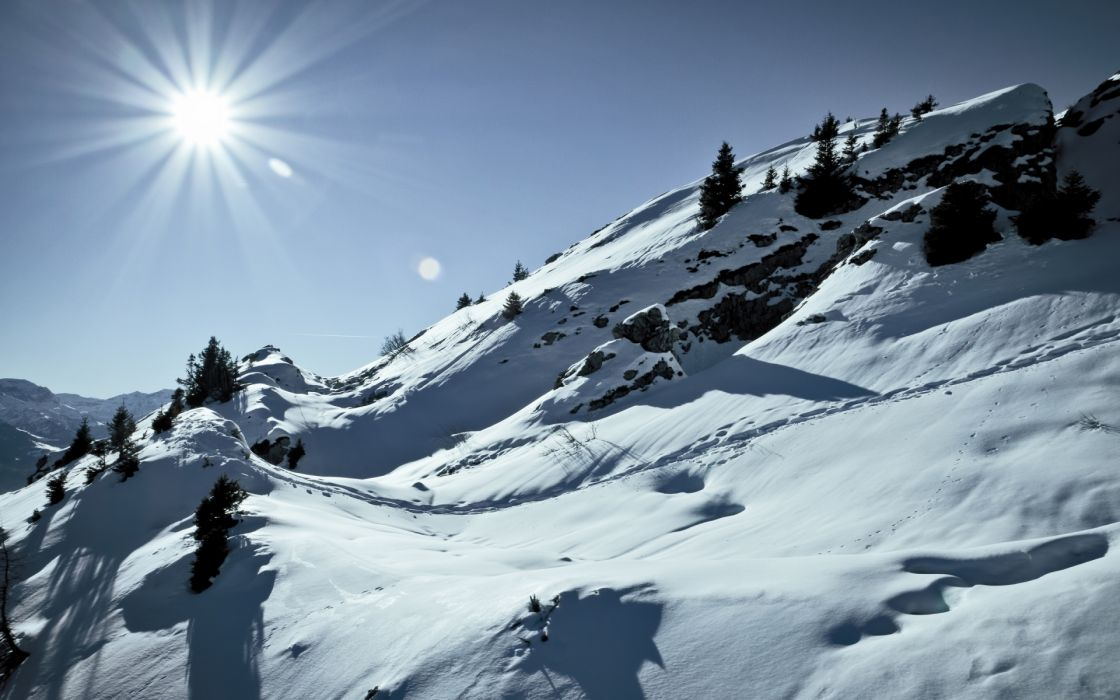 landscapes mountains snow winter sunlight beams rays sky wallpaper