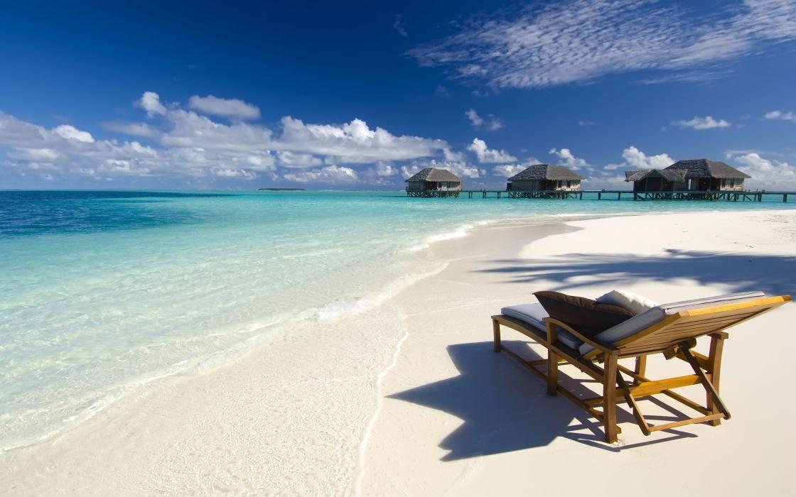 Maldives Conrad Beach ocean sea seascape resort cabin houses dock pier tropical vacation chair waves sky clouds wallpaper