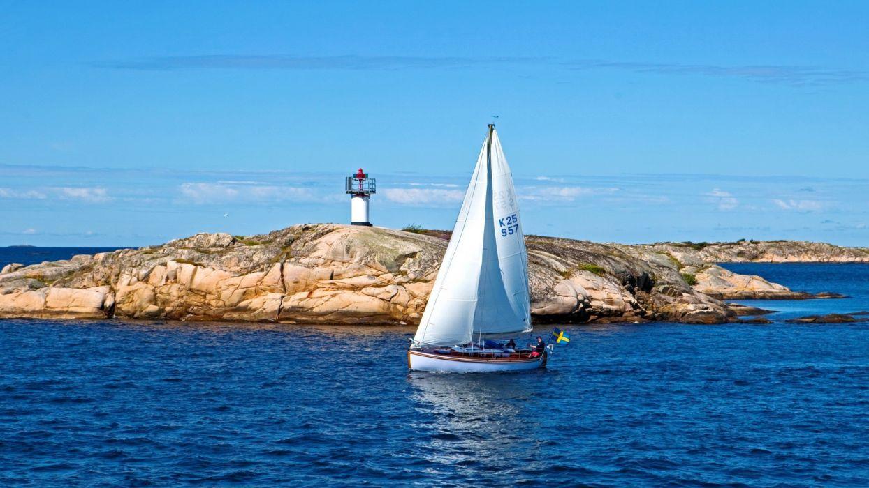 sailing sports boats lighthouse islands ocean sea sky wallpaper