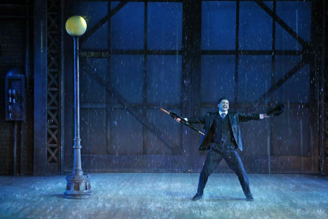 Singin' In The Rain play musical dance men rain drops wallpaper