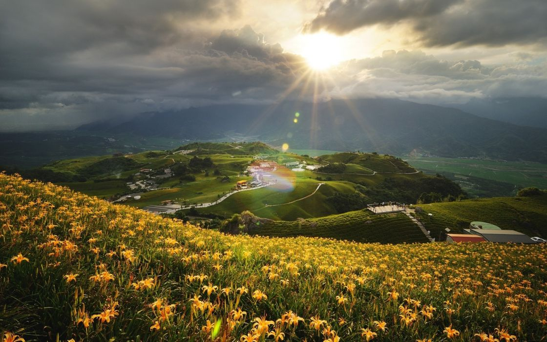 sky clouds sunlight sunset sunrise flowers fields town village hamlet buildings houses wallpaper